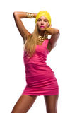 Disco style fashion girl. Fashion studio shot of young and beautiful woman wearing pink dress, on white background Royalty Free Stock Photos