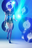 Disco woman dancing with vinyl records and neon lights Stock Image