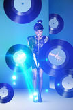Disco woman screaming with vinyl records in hands and neon light Royalty Free Stock Photos