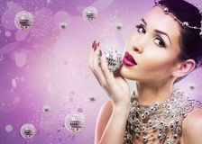 Disco woman side profile on purple backgound Royalty Free Stock Photos