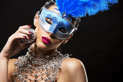 Disco woman wearing silver accessories on black backgound Stock Photography