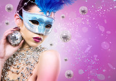 Disco woman wearing silver accessories on purple backgound Stock Photos