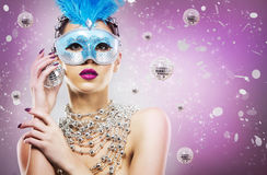 Disco woman wearing silver accessories on purple backgound Stock Images