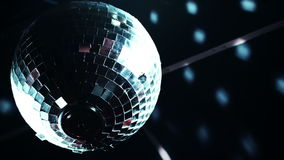 Discoball mirrorball spinning reflecting light into a club venue stock video