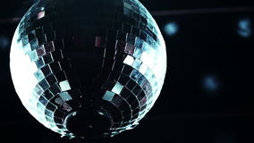 Discoball mirrorball spinning reflecting light into a club venue stock video footage