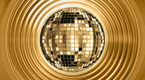 Discoball. The view of disco ball in gold background Royalty Free Stock Photos