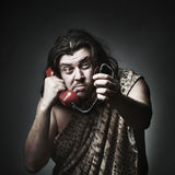 Disconnect. Wildman in leopard skin use retro telephone Royalty Free Stock Images