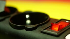 Disconnecting electrical appliances from the power supply theme. Close-up of a finger disconnects the red button to turn on the 22