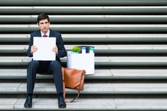 Disconsolate businessman holding a blank sign Royalty Free Stock Photography