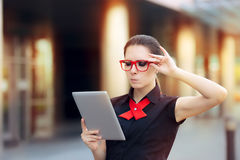 Discontent Businesswoman with Pc Tablet and Red Glasses Stock Photo
