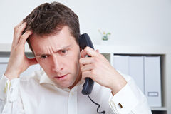 Discontent manager on the phone Royalty Free Stock Image