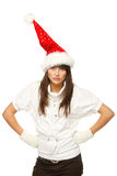 Discontent Santa girl. With hands on her waist, isolated on white background Stock Image