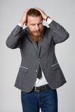 Discontent stressed hipster business man Stock Photo