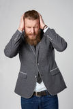 Discontent stressed hipster business man Royalty Free Stock Photo