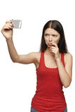 Discontent woman taking pictures of herself through cellphone Royalty Free Stock Photo
