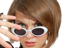 Discontent young woman in sunglasses Stock Photo