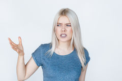 Discontent young woman on white background. Stock Photography