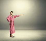 Discontented housewife screaming and pointing. At empty copyspace over grey background royalty free stock images