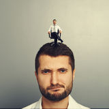 Discontented man with happy successful man Royalty Free Stock Photos