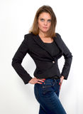 Discontented woman. Girl in jeans and jacket on a white background royalty free stock photo