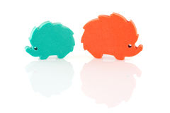 Discord. 2 colored hedgehogs (foam plastic silhouettes) with reflections, white background Stock Image