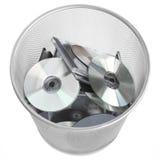 Discos de Digitaces en cubo de basura Fotos de archivo libres de regalías
