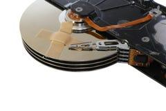 Discos duros quebrados con una tirita Imágenes de archivo libres de regalías