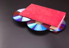 Discos no livro Foto de Stock Royalty Free