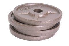 Discos para las pesas de gimnasia foto de archivo