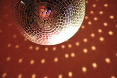 Discotheque light ball luminary on red ceiling Royalty Free Stock Photography