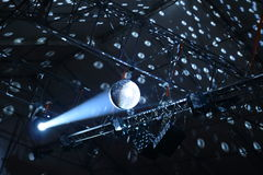 Discotheque mirror ball with pin spots and haze stock photo Stock Photography