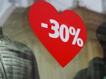 Discount 30% on the background of the heart royalty free stock image