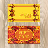 Discount card template with peacock feathers design. Royalty Free Stock Images