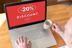 Discount concept on a laptop. Man using a laptop with discount concept on the screen Stock Photo