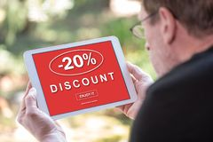 Discount concept on a tablet. Tablet screen displaying a discount concept royalty free illustration