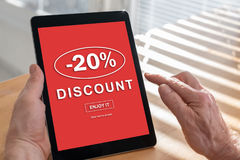 Discount concept on a tablet. Tablet screen displaying a discount concept Royalty Free Stock Photography