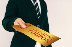 Discount coupon concept. Businessmen send gold discount card Royalty Free Stock Image