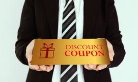 Discount coupon concept. Businessmen send gold discount card Royalty Free Stock Images