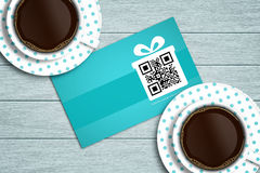 Discount coupon lying on wooden desk with coffee Stock Image