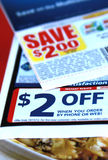 Discount coupons. Saving discount manufacturer coupons on display Royalty Free Stock Photos