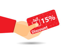 Discount coupons in hand. 15-percent discount. Special offer. Gift boxes on background. Royalty Free Stock Photography