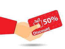 Discount coupons in hand. 50-percent discount. Special offer. Gift boxes on background. Royalty Free Stock Images