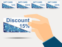 Discount coupons in hand. 15-percent discount. Special offer. Set gift card. Stock Photos