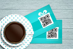Discount coupons lying on wooden desk with coffee Royalty Free Stock Photography