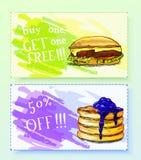 Discount coupons for pancake and gamburger. Stock Image