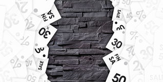 Discount coupons on texture of gray wall royalty free stock image