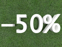 Discount Fifty Percent. Discount of fifty percent on green grass with white text Stock Photo