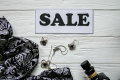 Discount on items on white wood background with black and white tag Royalty Free Stock Image