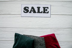 Discount on items on white wood background with black and white tag stock photos