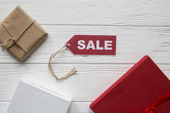 Discount on items on white wood background with red tad Stock Photo